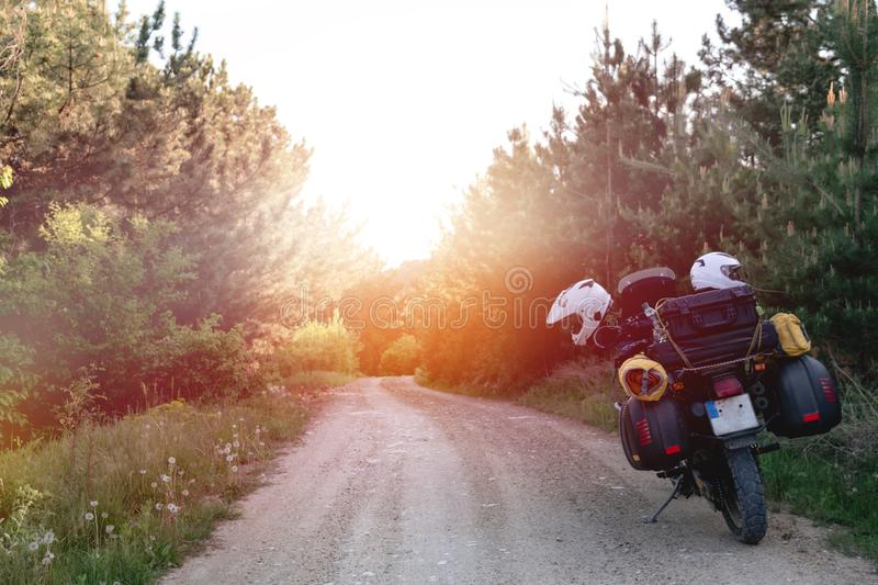 Tourist motorcycle with side bags. enduro advetnture, space for text, summer day. Adventure expedition, explore, dirt road,. Offroad royalty free stock image