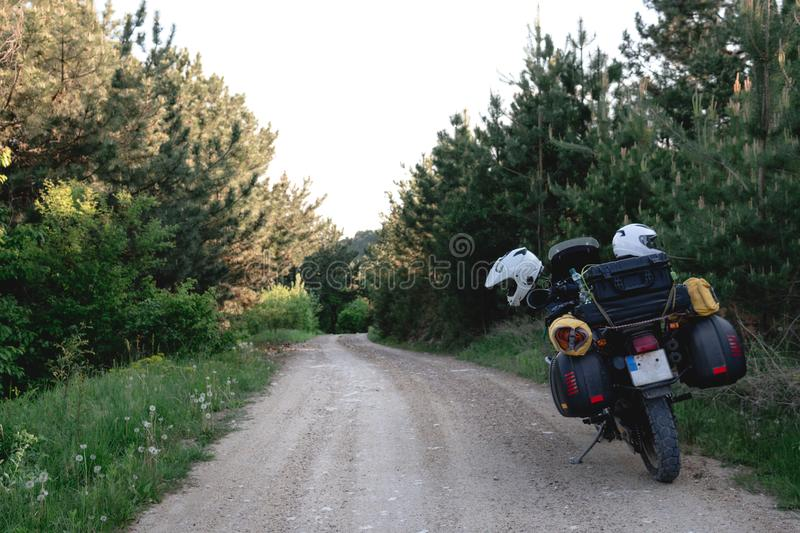 Tourist motorcycle with side bags. enduro advetnture, space for text, summer day. Adventure expedition, explore, dirt road,. Offroad stock photos
