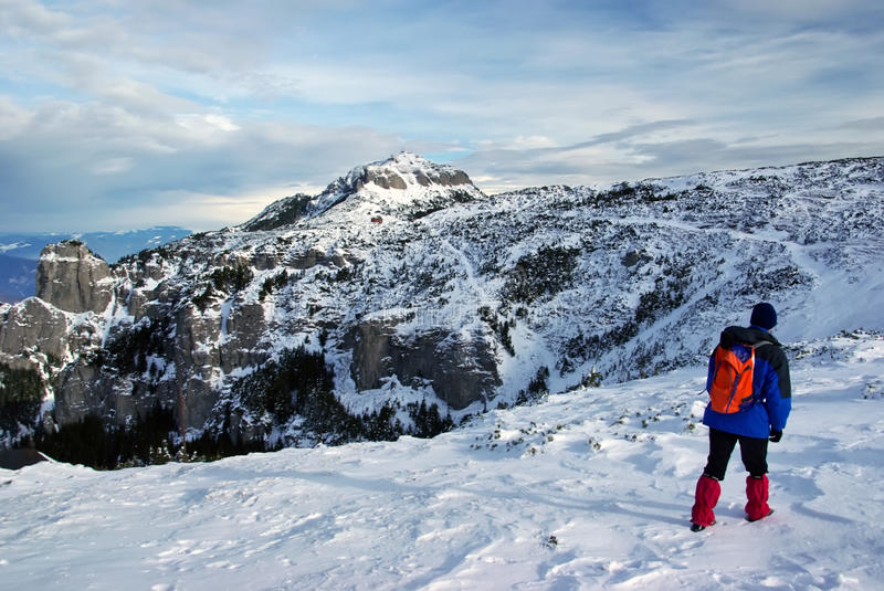 Tourist on mountain. In winter stock images