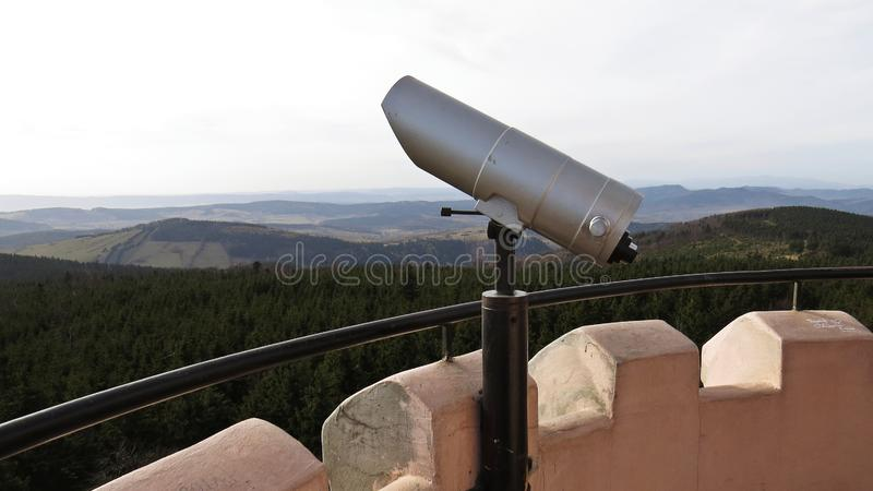 Tourist Observation Telescope on a Watch Tower with Mountains in Background. Tourist Observation Telescope on a Watch Tower with Mountains in the Background stock photography