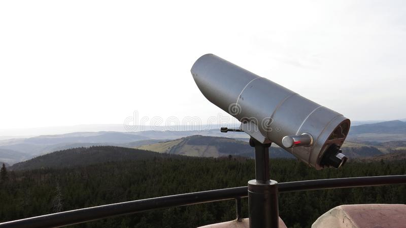 Tourist Observation Telescope on a Watch Tower with Mountains in Background. Tourist Observation Telescope on a Watch Tower with Mountains in the Background royalty free stock photo