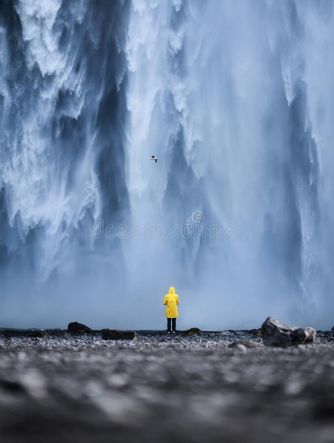 Free Tourist On The Skogafoss Waterfall Background. Travelling On Iceland. Tourist In The Famouns Place In Iceland. Stock Images - 178218704