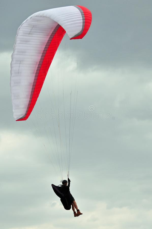 Tourist paragliding on adventure holiday royalty free stock photography