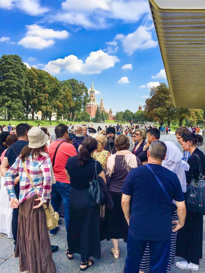 Tourist people on tour in Moscow Kremlin, Spasskaya clock tower, Red Square stock photo