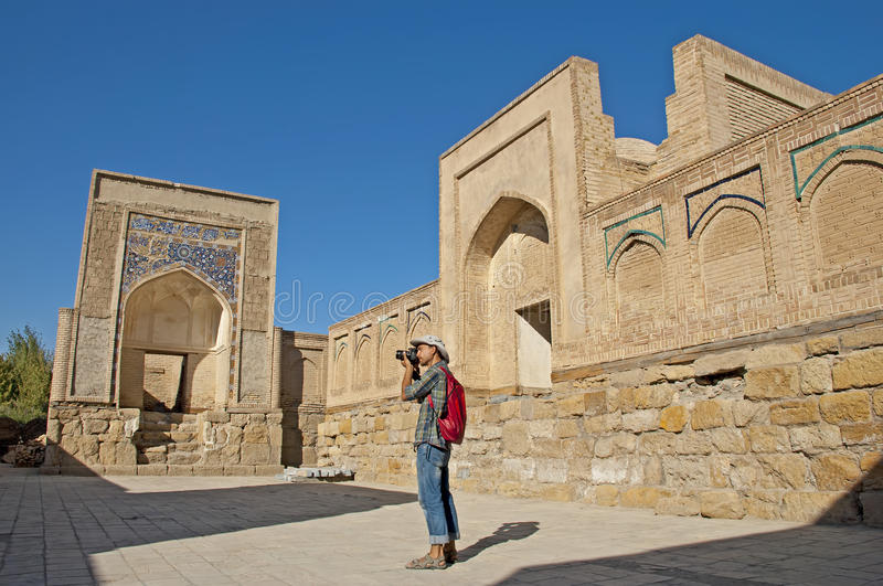 Tourist photographer in the memorial complex of Chor-Bakr stock image