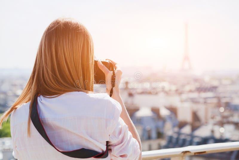 Tourist photographer in Paris taking photo of Eiffel tower royalty free stock photo