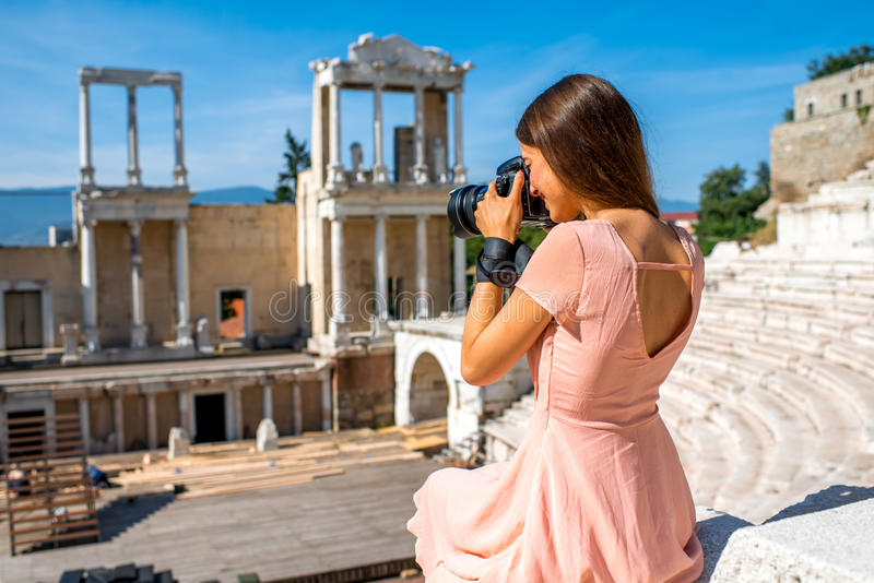 Tourist photographing Roman theater in Plovdiv royalty free stock photography