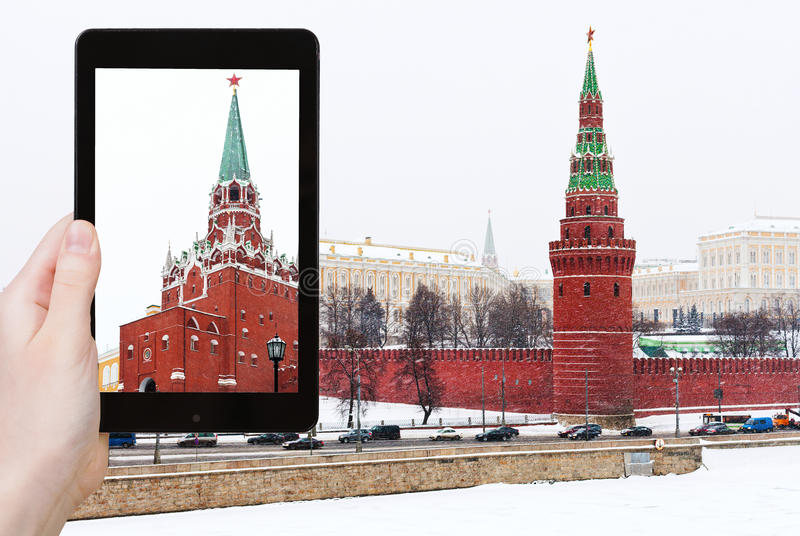 Tourist photographs Kremlin in winter snowing day royalty free stock photos