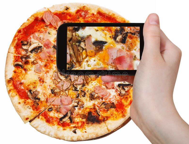 Tourist photographs of pizza with prosciutto cotto royalty free stock photography