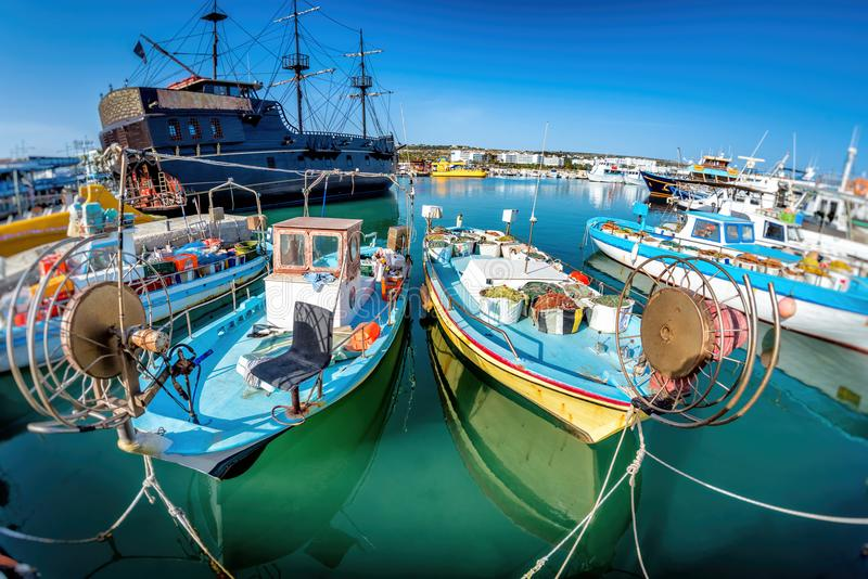 Tourist `Pirate ship` and moored fishing boats in harbour at Ayia Napa. Famagusta District. Cyprus stock photo