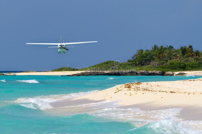 Download Tourist Plane Flying Over Caribbean Beach Stock Photo - Image: 22237020