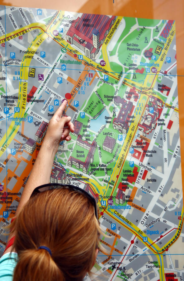 Tourist Pointing  At The Centercity Map Stock Photography