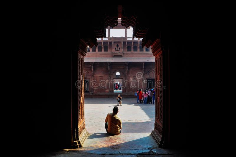 A tourist poses in Agra Fort, Agra, India. stock image