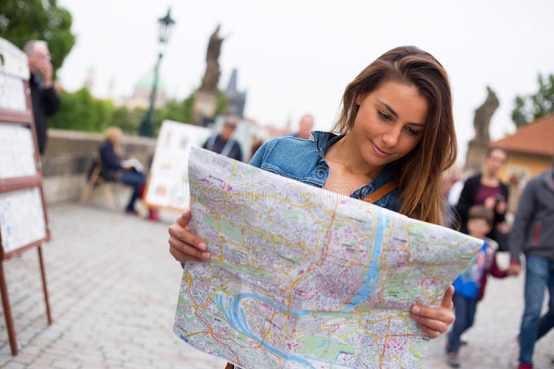 Tourist in Prague. A young tourist reading a map on charles bridge in Prague royalty free stock photos