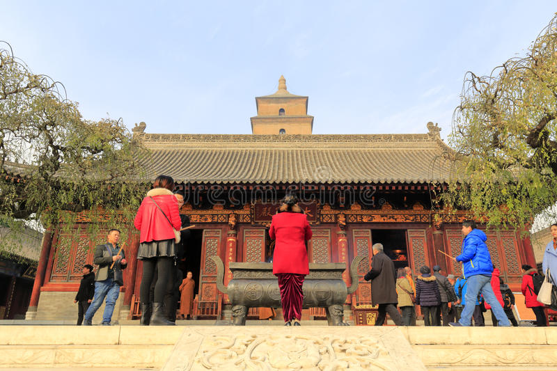 Tourists pray in front of the main hall of daciensi temple, adobe rgb stock photo