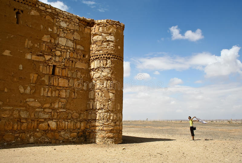Tourist and Qasr al Kharanah, Jordan stock image