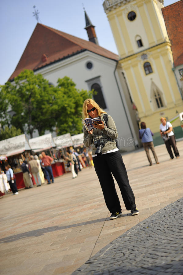 Download Tourist reading guidebook stock photo. Image of holiday - 14883782