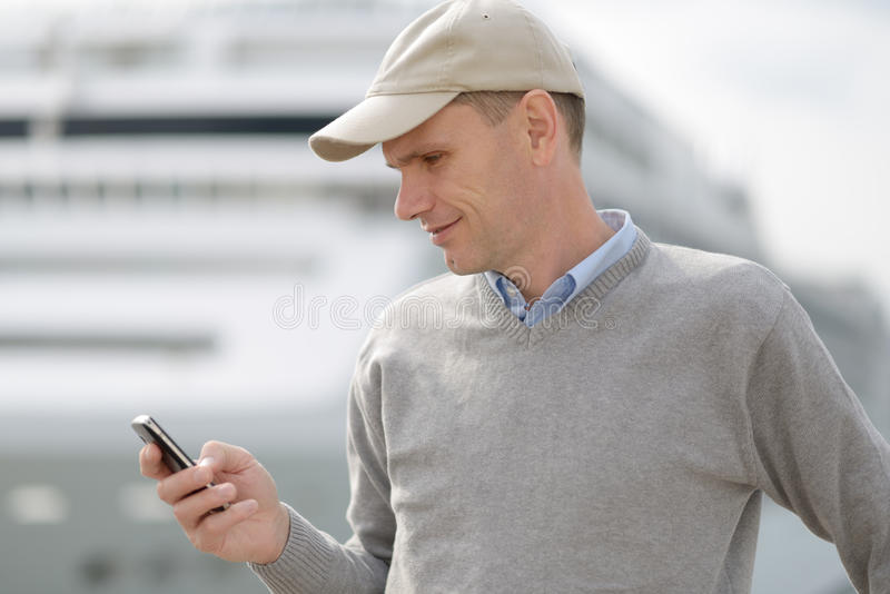 Tourist reading SMS stock photos