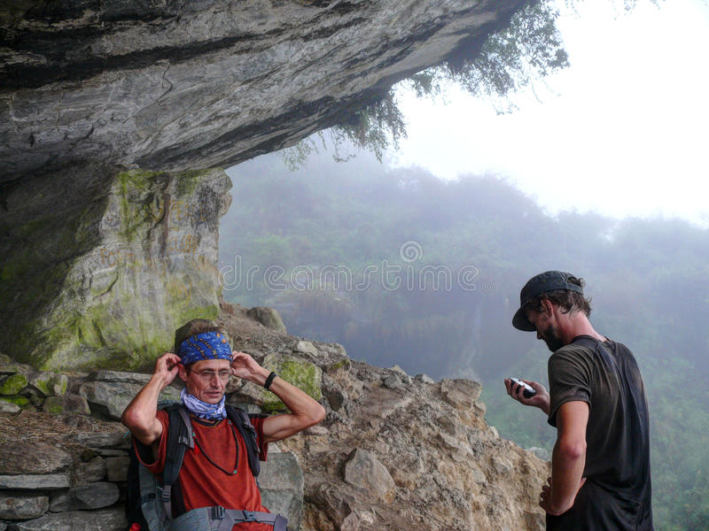 Tourist relaxing in Hinku Cave, Nepal stock photo