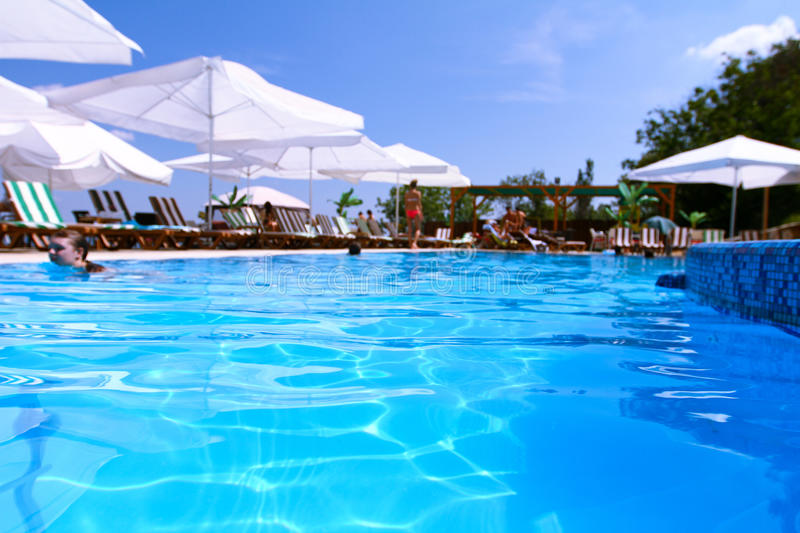 Download Tourist Resort With Pool, White Parasols And People Stock Photo - Image: 29440712