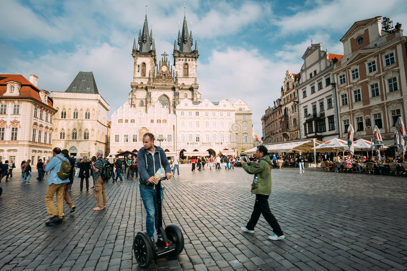 Tourist rides a electric scooter Segway on old stock photo