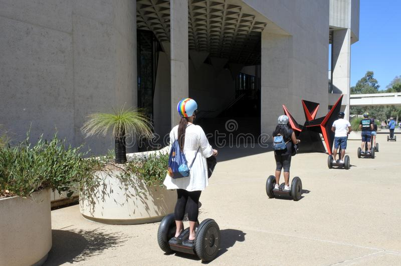 Tourist riding on Segway outside the National Gallery of Australia in Canberra Australia Capital Territory royalty free stock images