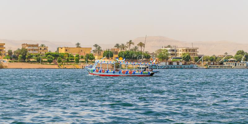 Tourist riverboat cruising on the Nile in Luxor, Egypt stock photo