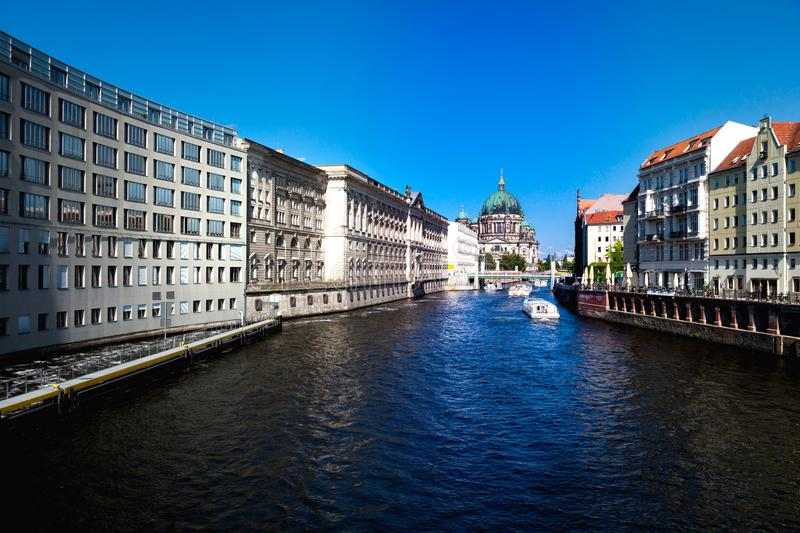 Tourist riverboats on the spree Berlin. Tourist riverboats on the river Spree Berlin looking towards the Berliner Dom cathedral royalty free stock photo