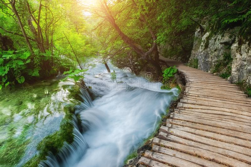 Tourist route on the wooden flooring along the waterfall at the Plitvice Lakes National Park, Croatia stock photography
