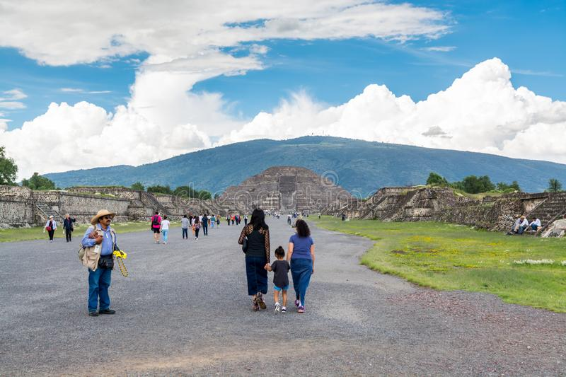Tourist in the ruins of the architecturally significant Mesoamerican pyramids and green grassland located at at Teotihuacan, an. Ancient Mesoamerican city royalty free stock images