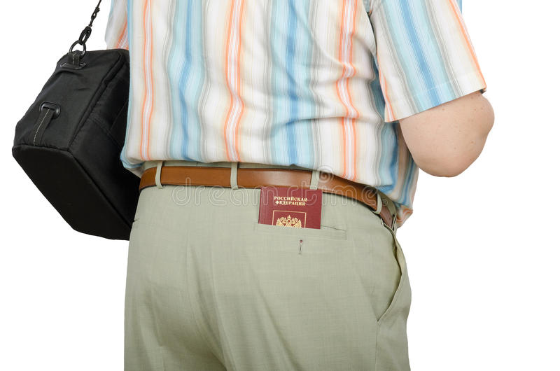 Tourist with Russian passport in rear pocket. Tourist with Russian passport in right rear pocket of summer pants. View from the back on a white background stock photos
