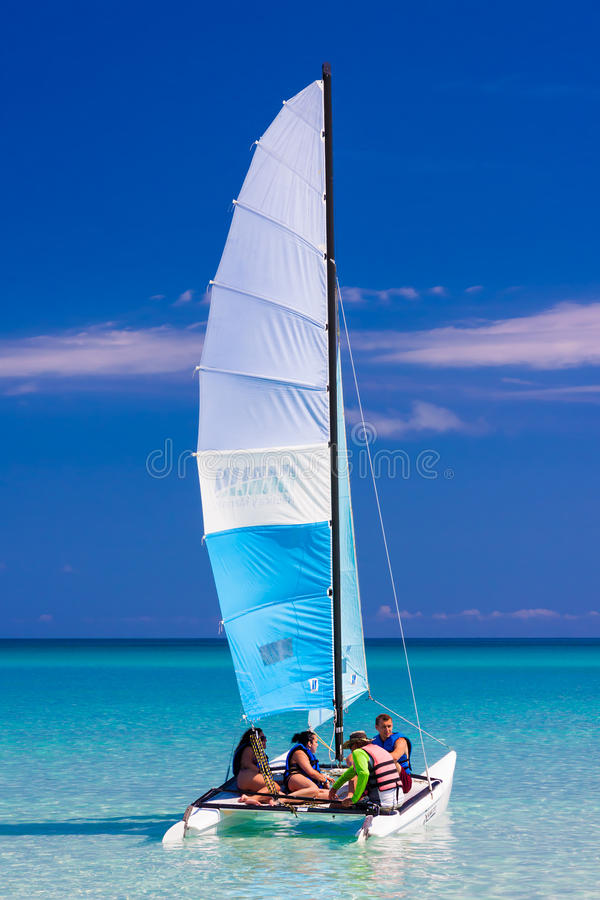 Tourist sailing in a catamaran on a cuban beach royalty free stock photography