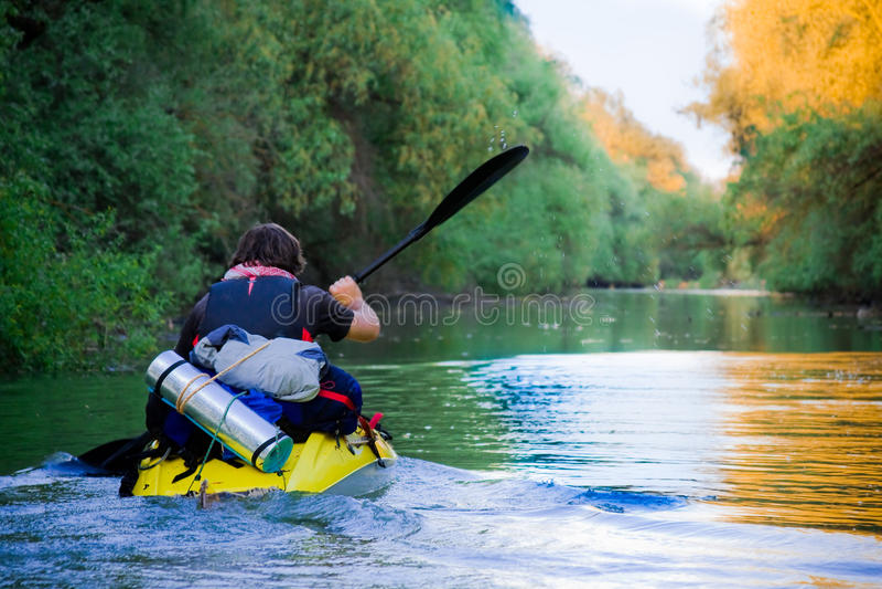 Tourist sailing on kayak royalty free stock photo