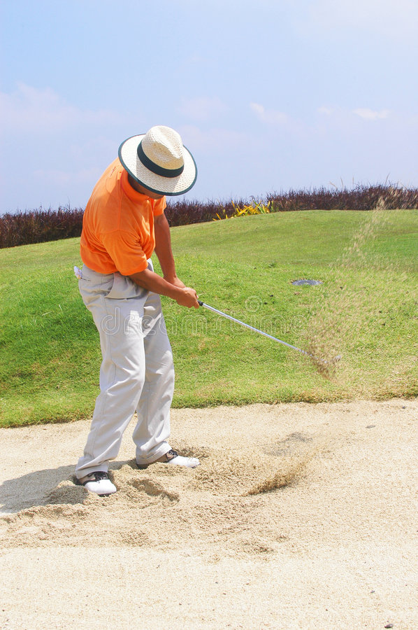 Tourist in sand trap stock image