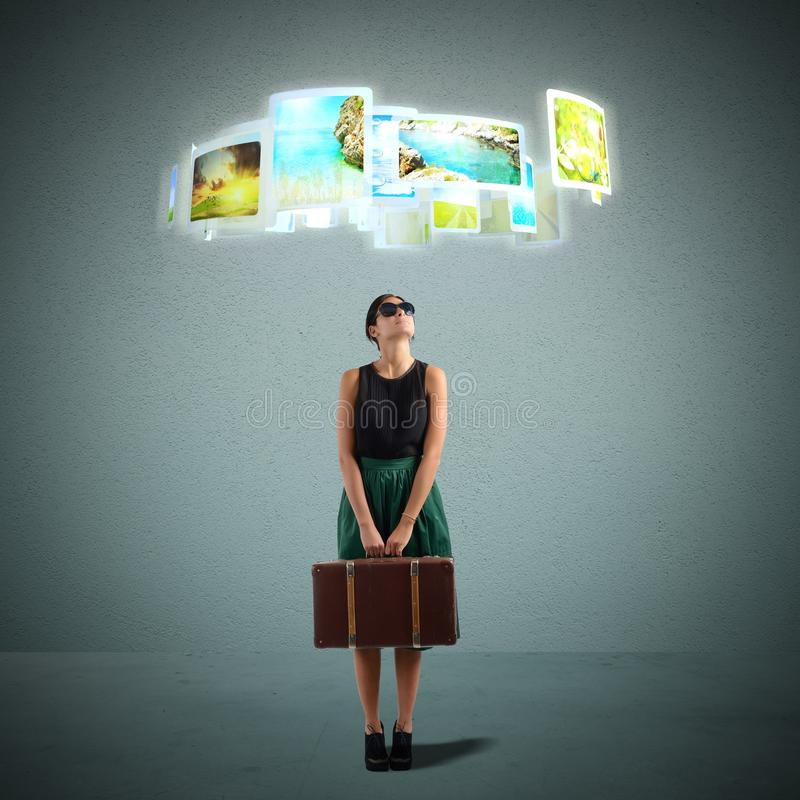 Tourist selects destination. Tourist selects her favorite destination from photos stock images