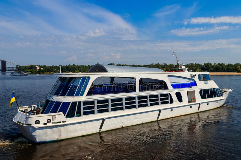 Tourist ship sailing on Dnieper river in Kiev. Tourist ship sailing on the Dnieper river in Kiev royalty free stock images