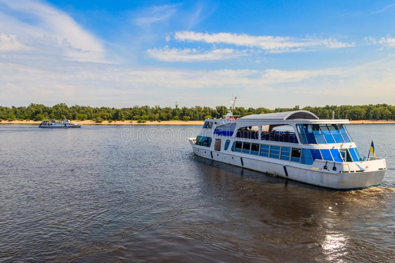 Tourist ship sailing on Dnieper river in Kiev. Tourist ship sailing on the Dnieper river in Kiev stock photography
