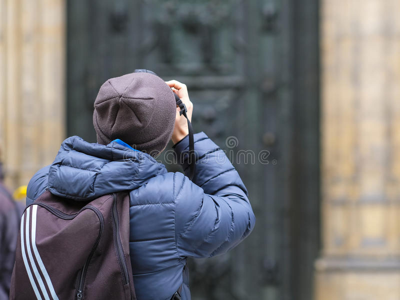 Tourist shoots St. Vitus Cathedral in Prague Castle stock photo