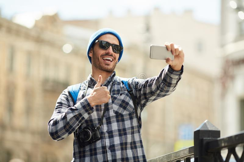 Tourist Showing thumbs Up royalty free stock photo