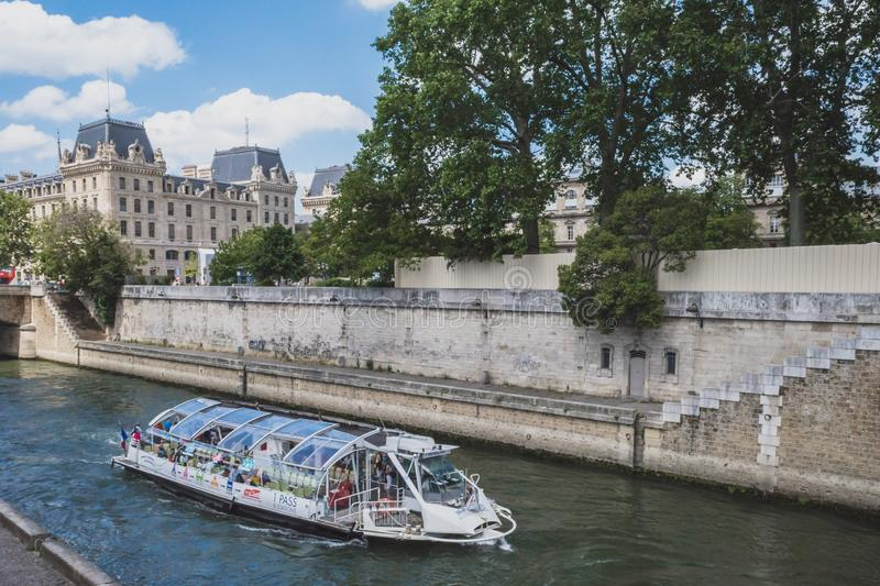 Tourist sightseeing cruise boat traveling down Seine royalty free stock photography