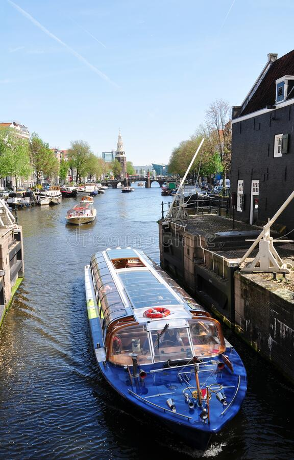 Tourist sightseeing cruise on the canal, Amsterdam, the Netherlands stock photos