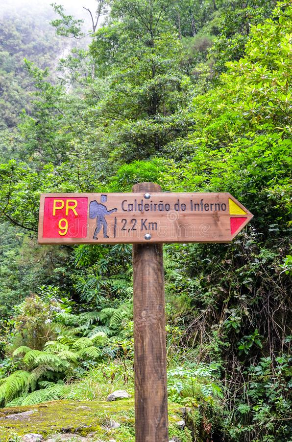 Tourist sign giving directions and distances on a hiking path in Caldeirao de Inferno, Madeira island, Portugal. Levada walking on. Portuguese island. Green stock images