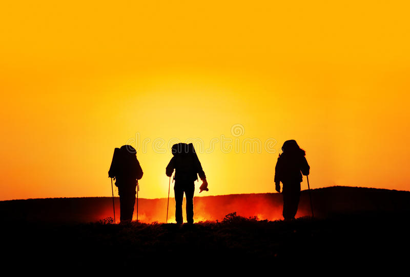 Tourist silhouettes at sunset stock image