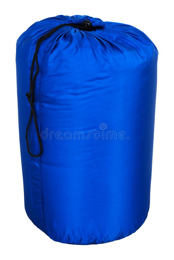 Tourist sleeping bag of blue color warm for hiking and for a tent, collapsed, isolated on white background. stock photography