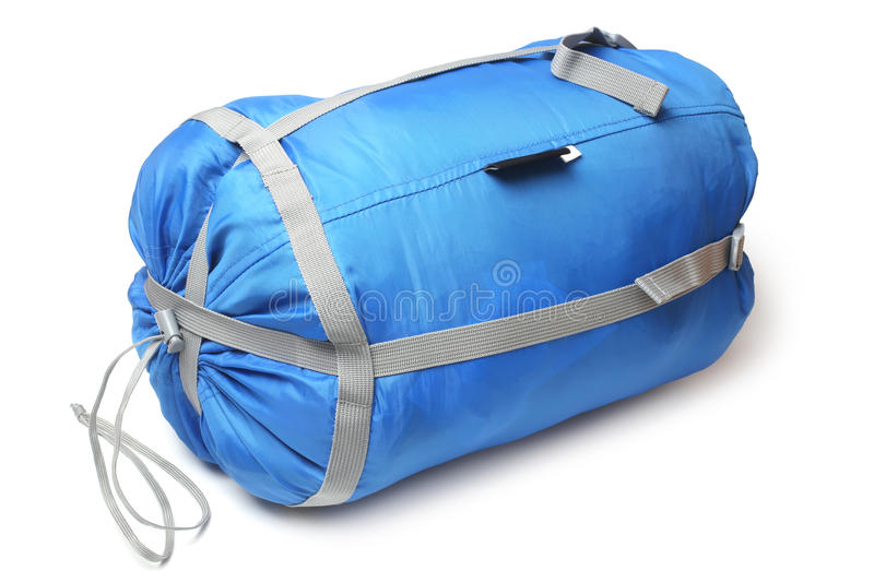 Tourist sleeping bag in a compression bag stock image