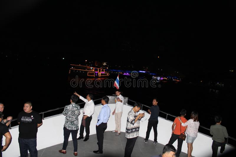 The tourist standing on the front of the yatch in Chao Phraya river in Bangkok, Thailand. royalty free stock photography