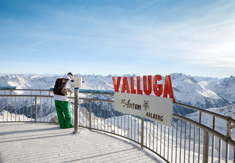 The tourist stands on sightseeing platform at Valluga royalty free stock photo