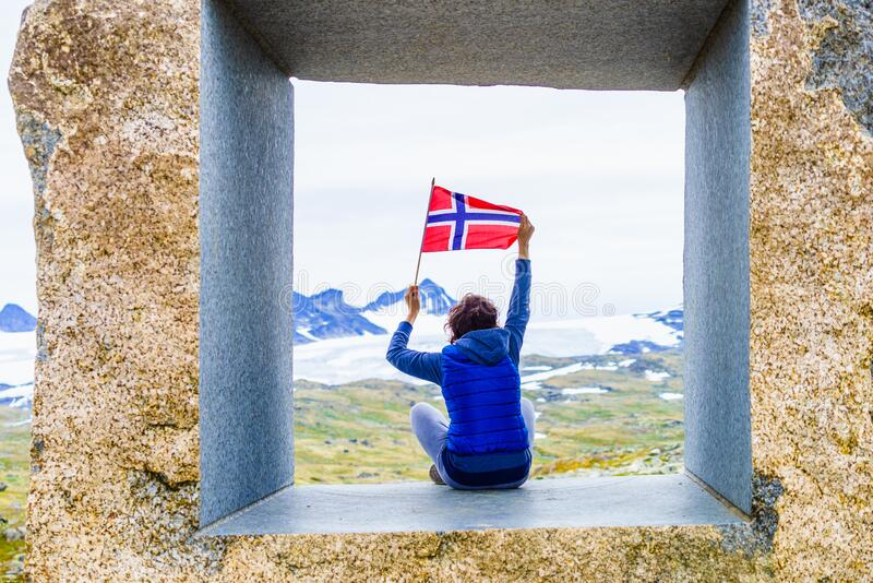 Tourist on stone sculpture in mountains, Norway royalty free stock images