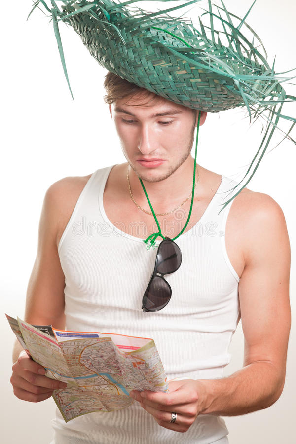Tourist in straw hat with map