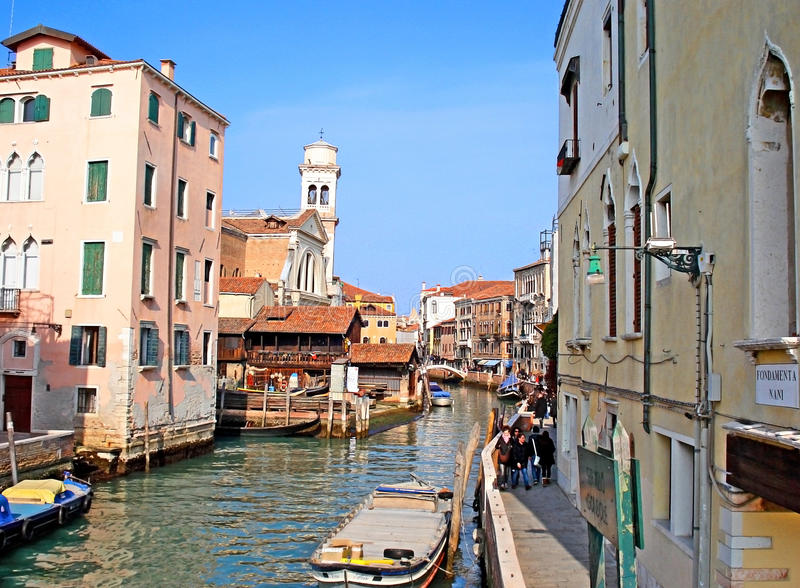 The tourist street. VENICE, ITALY - FEBRUARY 18, 2012: The narrow Rio San Trovaso is the home of original workshops for traditional Venetian boats, located in stock image